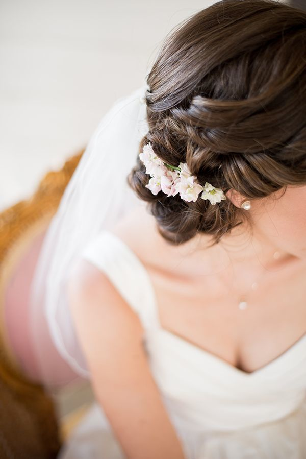 Bridal hairstyles_romantic updo with flower comb