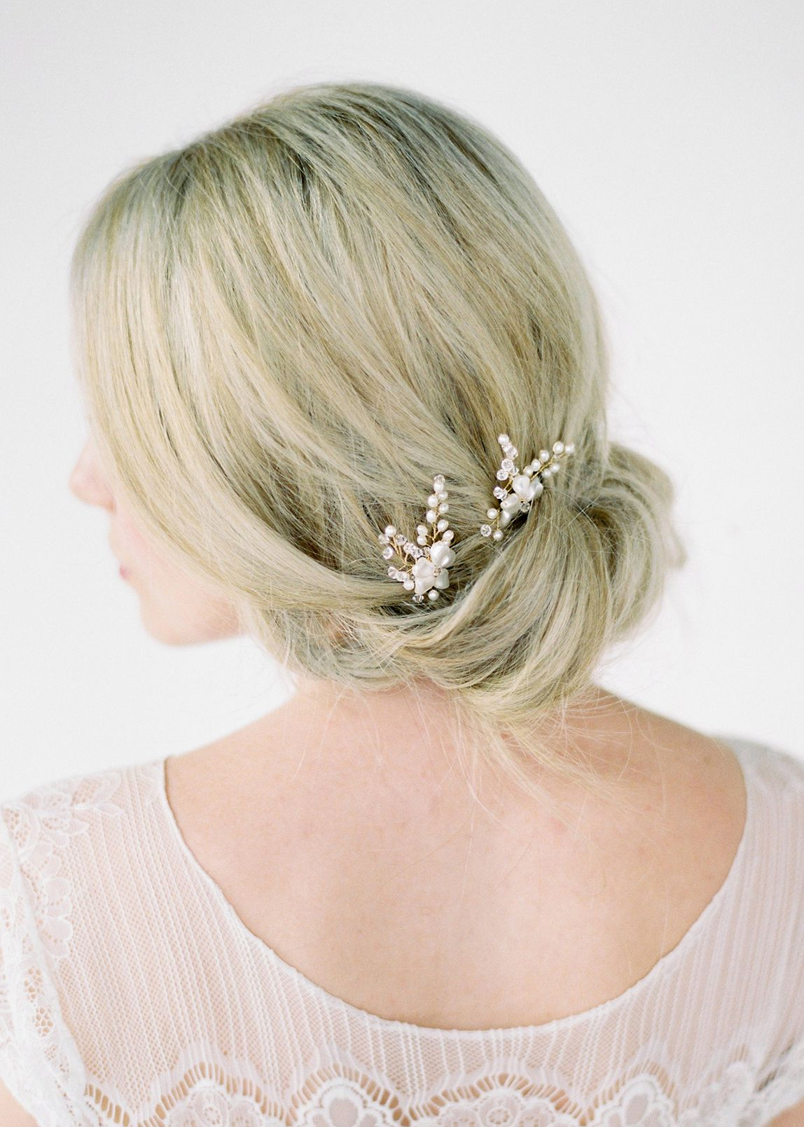 The Laura wedding hair pieces offer romantic and whimsical styling with minimal effort. These simple yet dainty hair pins are all about timeless beauty.