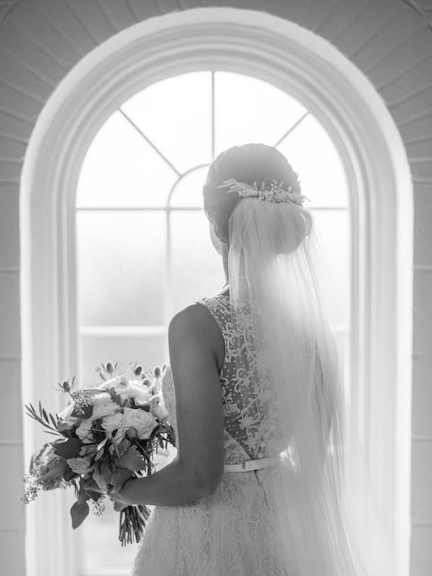 Bride Anna wearing Wild Willows bridal headpiece above a bun