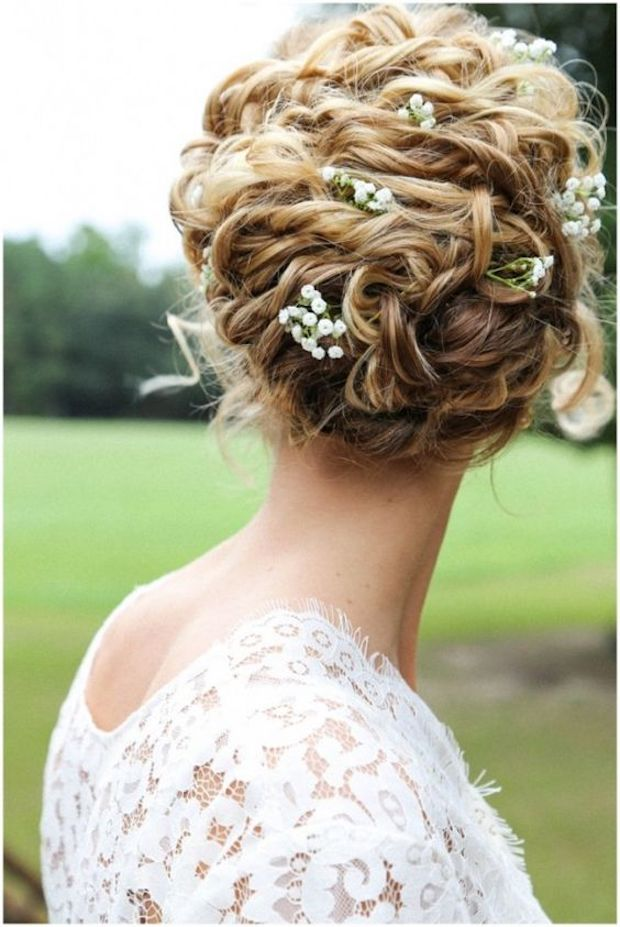 Naturally curl messy updo with flowers
