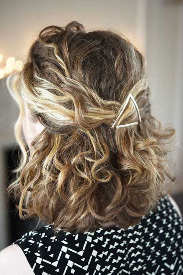 Naturally curly half up hairstyle with clip