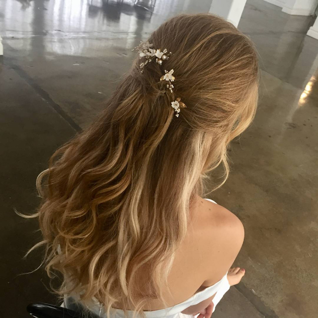 Half up hairstyle with floral hair pins - 2018 wedding hair trends