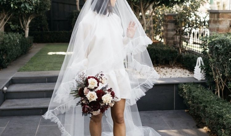 Your guide to short wedding dresses with veils